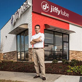 Jiffy Lube franchisee in front of store